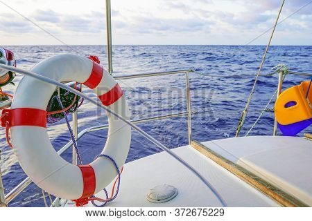 Lifebuoy Aboard A Yacht. Sailing Boat Wide Angle View In The Sea. Yachting As A Luxury Sport And Gre