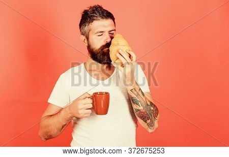 Aroma Of Fresh Baked Croissant. But First Coffee. Bearded Hipster Enjoy Breakfast Drink Coffee. Morn