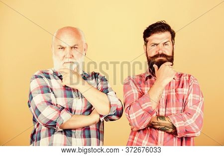 Brutal And Confident. Youth Vs Old Age Compare. Retirement. Two Bearded Men Senior And Mature. Barbe