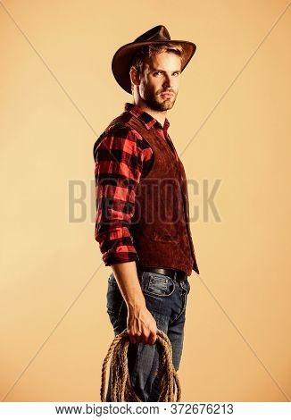Western America. Cowboy With Lasso Rope. Western. Vintage Style Man. Wild West Retro Cowboy. Man Che
