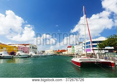 Main water canal with ships and shops in Bridgetown, capital of Barbados. Caribbean
