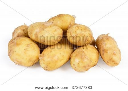 Pile Of The Raw Washed Yellow Young Potatoes With Unpeeled Thin Skin On A White Background