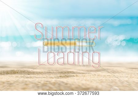 Summer Loading Words On Blur Tropical Beach With Bokeh Sunlight Wave Abstract Background. Summer Vac