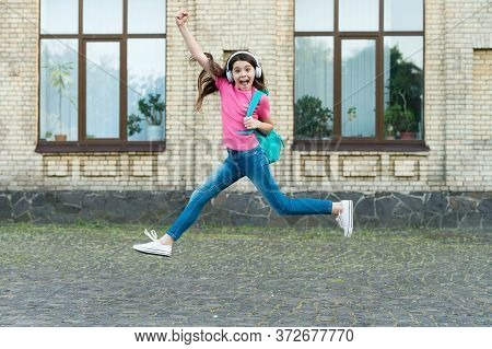 Energetic Drive. Happy Child In Energetic Jump Outdoors. Energetic Mood. Music And Entertainment. Sc