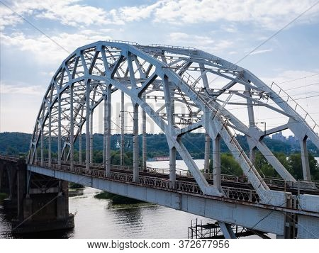 Span Of The Railroad Bridge With Steel Riveted Arch Truss Over The River. Fragment Of The Darnytskyi