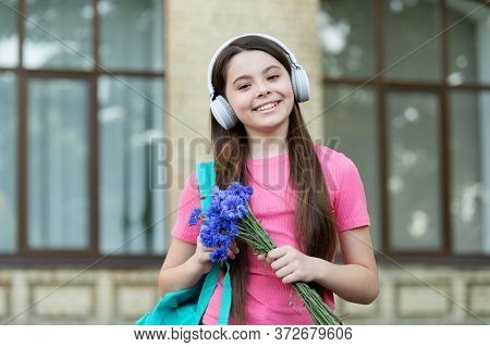 It Sounds Cool. Cool Girl Listen To Music Outdoors. Happy Child Use Headphones For Listening. Cool M