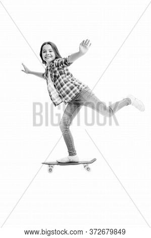 Street And Park Skateboarding. Happy Child Ride Penny Board. Little Girl Perform Skateboarding Trick