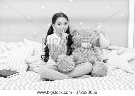 Girls Secret. Cute Kid Show Silence Finger Gesture. Little Secret. Small Girl Play With Teddy Bear I