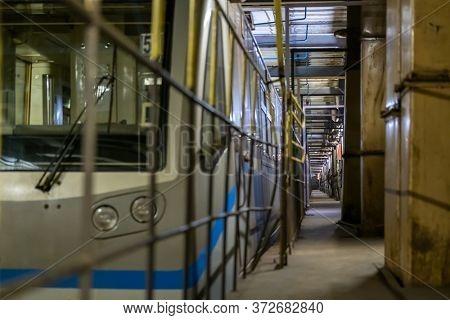 Long narrow hallway with metal frames on doorways going through modern industrial building
