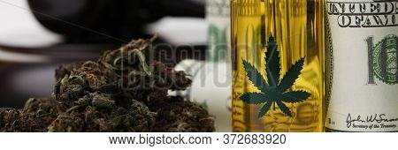 Judges Table Are Dollars, Hemp Oil And Marijuana. Illicit Manufacture Cannabis Products. Auditory An