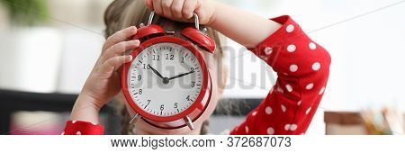 Baby Dress Covered Her Face With Large Alarm Clock. Get To Know Numbers And Numbers On Watch. Differ