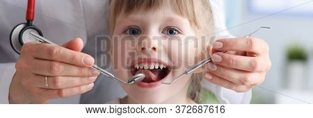 Little Girl Is Not Afraid To Show Teeth To Dentist. Prophylactic Examinations Child At Dentist. High