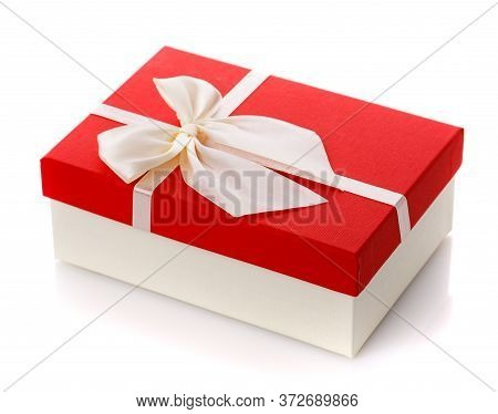 White Gift Box With Red Lid And Big White Bow On A White Background.