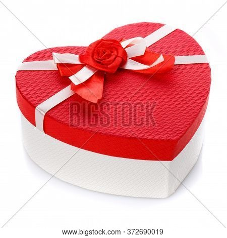 Red And White Gift Box In The Form Of A Heart With A Flower In The Middle. Isolated On White Backgro