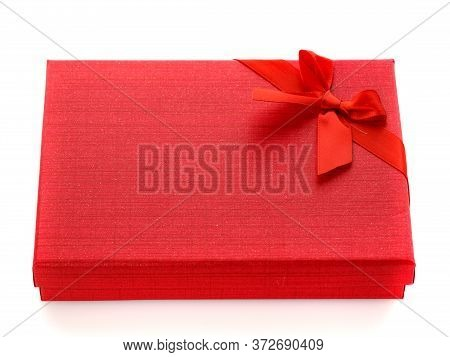 Red Gift Box With Red Ribbon Bow Isolated On White Background. Side View.