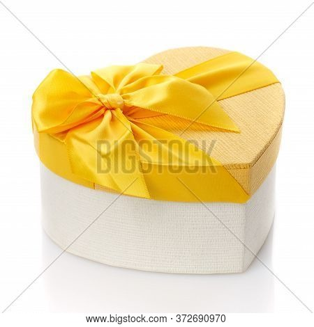 Beautiful Heart Shaped Gift Box With Big Yellow Bow. Isolated. Side View.