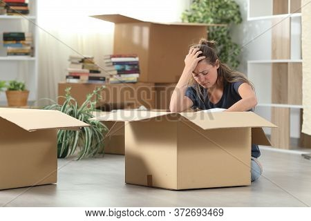 Sad Evicted Woman Complaining Moving Out Packing Boxes Sitting On The Floor At Home