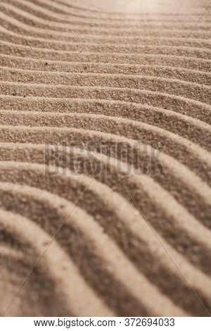 Sand On The Beach Close Up. Wavy Texture Sand.