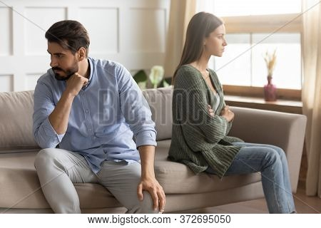 Unhappy Stressed Man And Woman Ignoring Each Other After Quarrel