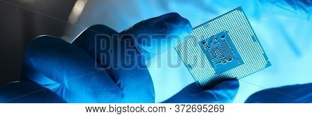 Close-up Gloved Hands Holding Detail Microchip. Man In Special Uniform Shows Microprocessor Chip. Pr
