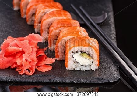 Beautiful Philadelphia Rolls With Salmon And Cream Cheese On A Plate Of Black Slate.
