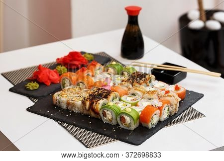A Set Of Sushi From Many Types Of Roles And With Different Stuffing. Sushi Menu.