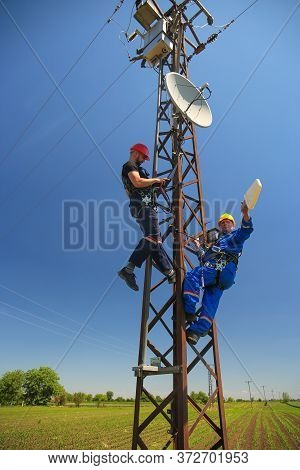 Two Electricians Install 4g Telecommunications Antenna System