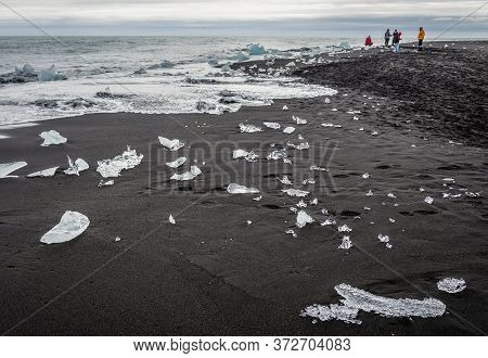 Eastern Region, Iceland - June 12, 2018: Pieces Of Ice On So Called Diamond Beach On The Atlantic Sh