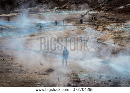 Hverir, Iceland - June 19, 2018: Tourists In Hverir Geothermal Area With Boiling Mudpools And Steami