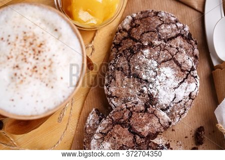 Chocolate Chip Cookies On A Brown Table. Place For Text. Blurred Background.