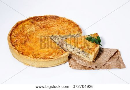 Delicious Baked Pie With Meat, Mushrooms, Cheese And Herbs On A White Background.