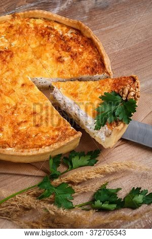 Homemade French Pie With Champignons And Cheese Over Rustic Wooden Background. Delicious Mushroom An