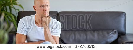 Feeling Depressed. Desperate Young Man Sitting On The Couch At Home.