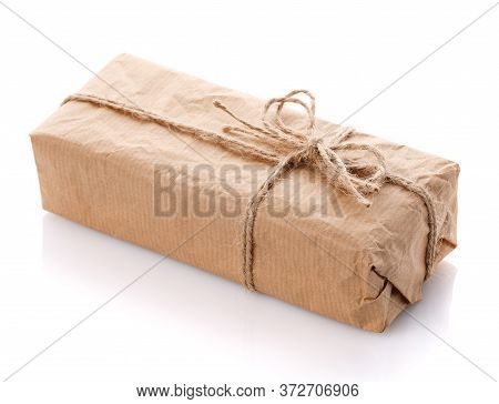 Gift Box Wrapped With White Paper And Burlap Ribbon Isolated On White Background.