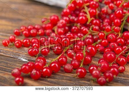 Currants On Wooden Table Background, Spilled From A Jar. .antioxidants, Detox Diet, Organic Fruits.