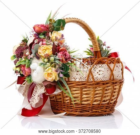 Provence Easter Floral Arrangement On A White Wicker Basket With A Vine. Isolated. Ribbons And Lace.