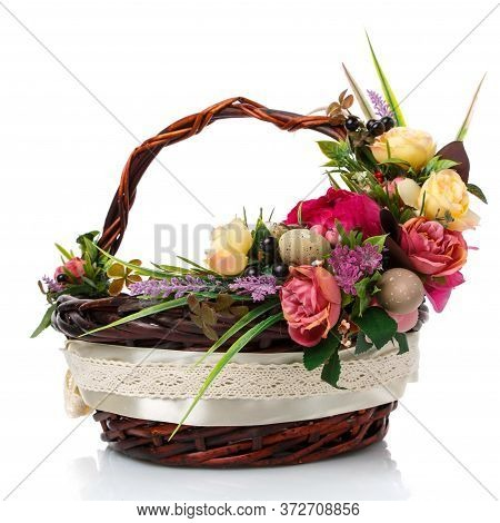 Dark Brown Wicker Basket With Original Handle And Floral Decoration On A White Background. Decor Of
