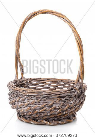 Dark Brown Round Wicker Basket With High Handle. Isolated. Handmade.