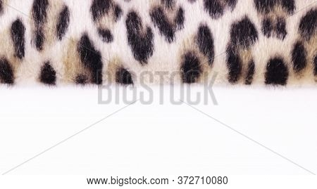 Beautiful Leopard Faux Fur On White. Texture Or Background Concept. Close Up. Copy Space Mock Up.ban