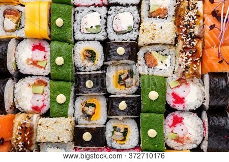 Sushi Set Background. Huge Set Of Rolls With Different Stuffing. Salmon, Tuna, Eel, Avocado, Cucumbe