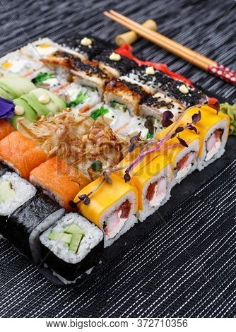 Sushi Roll Japanese Food In Restaurant On A Stone Board. Diferent Sushi Roll Set Close Up.