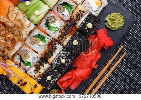 Different Types Of Asian Sushi Rolls On Gray Background. Close Up Top View.