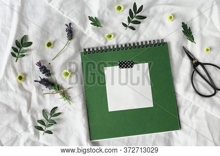 Summer Lifestyle Floral Composition. Green Diary, Sketch Book Mockup Scene With Blank Memo Pad. Lave
