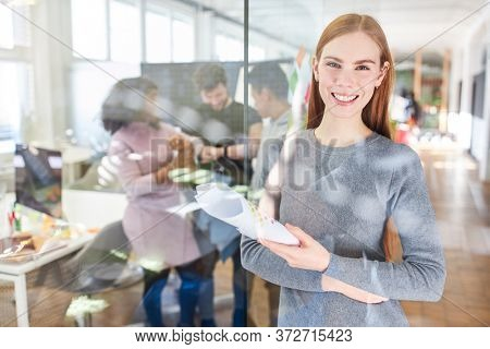Smiling young woman as a trainee or trainee for feminism and equality