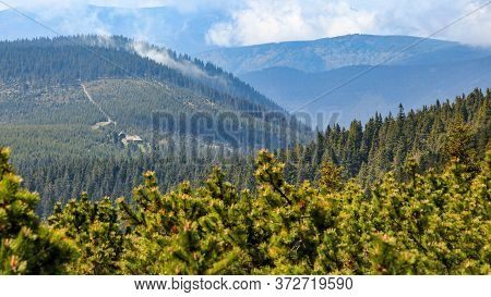 Misty Clouds Rolling Over Forest Hills, Frantiskova Myslivna Hut, Jeseniky, Czech Republic.