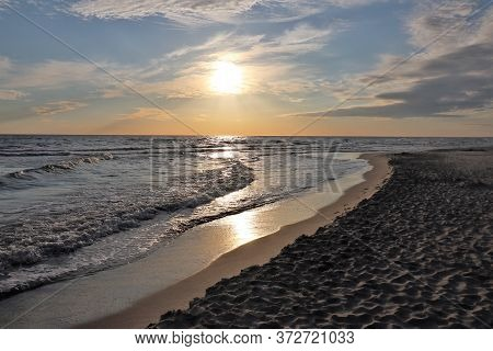 Picturesque Sea Coast With A Beach In The Evening.
