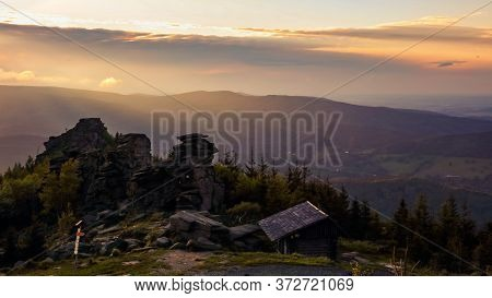 Wooden Tourist Shelter In Front Of Prominent Rock Formations During Sunset, Obri Skaly, Jeseniky, Cz