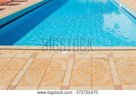 Swimming Pool With Nobody. Vacation Resort Outside Empty Pool With Blue Water. Outdoor Pool Property