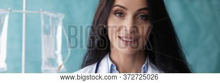 Beautiful Woman Doctor Stand With Folder Smiling. Maintenance And Restoration Vital Body Functions I