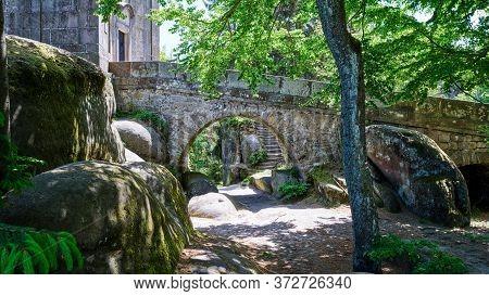 Marked Red Walking Path Leading Under Historical Stone Bridge, Nature Tourism Destination - Adrspach